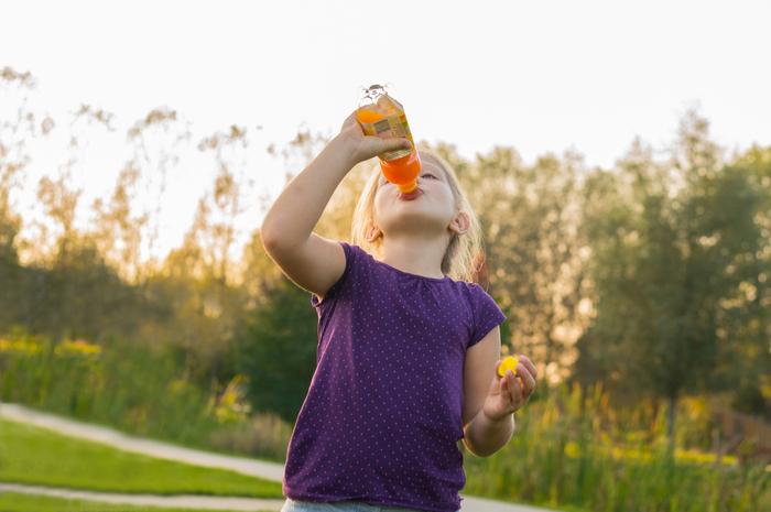 kid drinking sports drink