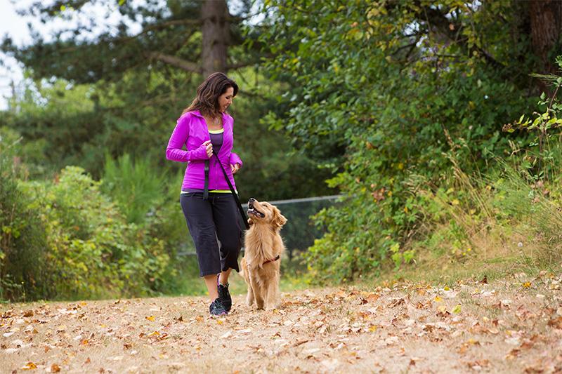 women walking her dog