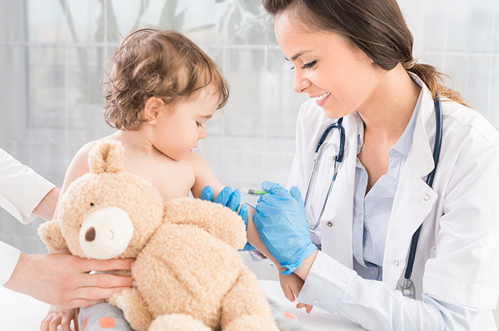child getting vaccination